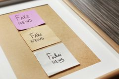 Stickers with words FAKE NEWS in frame, closeup royalty free stock photos