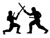 Stickfighters - 02. A duel between two practitioners of the Filipino Martial Arts Royalty Free Stock Photo