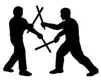 Stickfighters. Filipino Martial Arts practitioners engaged in Sinawali Stock Image