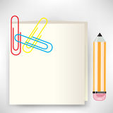Stickie note with pencil and clips Royalty Free Stock Photo