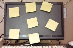 Stickies on computer screen. Blank stickie notes stuck on a computer monitor screen Stock Photo