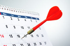 Sticking arrow into calendar. Stock Photography
