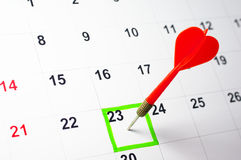 Sticking arrow into calendar. Royalty Free Stock Images