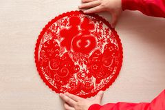 Sticking fluffy red flat paper-cut sticker as symbol of Chinese New Year of the pig the Chinese means good luck and lots of. Sticking a fluffy red flat paper-cut royalty free stock photography
