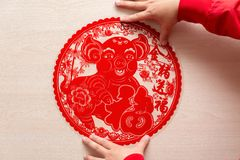 Sticking fluffy red flat paper-cut sticker as symbol of Chinese New Year of the pig the Chinese means good luck and the pig. Sticking a fluffy red flat paper-cut royalty free stock images
