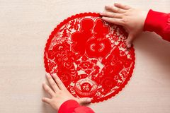 Sticking fluffy red flat paper-cut sticker as symbol of Chinese New Year of the pig the Chinese means good luck and the pig. Sticking a fluffy red flat paper-cut royalty free stock photos
