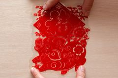 Sticking fluffy red flat paper-cut sticker as symbol of Chinese New Year of the pig the Chinese means good luck. Sticking a fluffy red flat paper-cut sticker as stock images