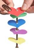 Sticking heart on iron nail Stock Image