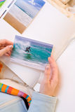 Sticking  images to photo album Royalty Free Stock Photography