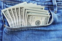 Sticking out money from blue jeans pocket, spending money concept. Us dollars currency royalty free stock image