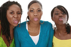 Sticking out tongues. Three friends sticking out tongues Stock Photo