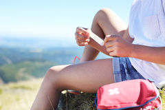 Sticking plaster. Child sticking plaster on knee Royalty Free Stock Image