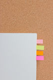 Sticking reminder on notepad. Sticking reminder on notepad with cocrkboard Stock Photography