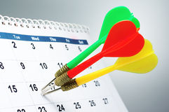 Sticking three arrows into calendar. Stock Image