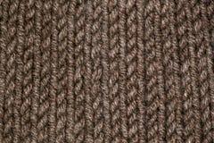 Stickmönster från beiga eller brunt woolen varmt mjukt garn Royaltyfri Fotografi