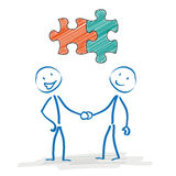 Stickman Handshake Puzzle Pieces. Stickman with puzzle pieces and handshake on the white background Stock Images