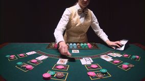Stickman woman distributes cards express play high stakes game poker in casino. Black background. Slow motion. Stickman woman distributes cards express play high stock footage