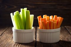 The sticks of carrots and celery stock photos