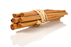 Sticks of cinnamon. Joined with string on the white background. Shallow DOF Stock Images