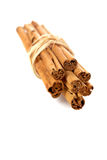 Sticks of cinnamon. Joined with string on the white background. Shallow DOF and soft shadow Stock Photos