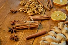 Sticks of cinnamon and anise stars on wooden brown background. Ingredients for mulled wine: dried fruits, orange, ginger, cinnamon Royalty Free Stock Image