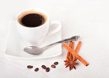 Sticks of cinnamon and an anisic star on coffee stock images