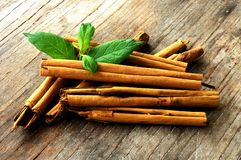 Sticks of cinnamon with mint leaf Royalty Free Stock Images