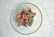 Sticks of cinnamon on textual background Stock Image