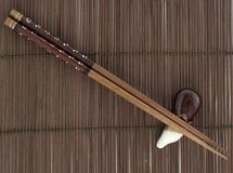 Sticks fo sushi on the mat Stock Photography