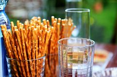 Sticks. Image of salty pretzel snack sticks in a glass on the table royalty free stock image