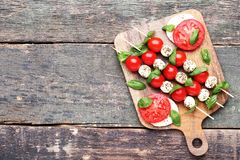 Mozzarella, tomatoes and basil leafs stock photography