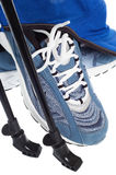 Sticks for Nordic walking and  sports shoes Royalty Free Stock Photos