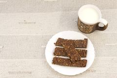 Sticks of oatmeal with chocolate, healthy breakfast Stock Photography