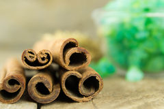 Sticks and powder aroma cinnamon on old wooden background Royalty Free Stock Photos
