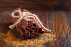 Sticks and powder of cinnamon, anise, sugar cane Royalty Free Stock Image
