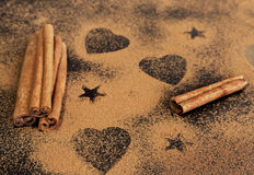 Sticks and powdery cinnamon on the black table Royalty Free Stock Photos