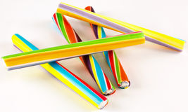 Candy sticks. Five colorful sticks of rock on a white background Stock Photo