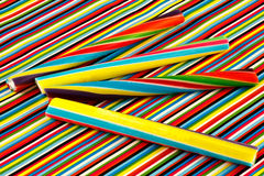 Sticks of rock. Four colorful sticks of rock on a colorful striped background Stock Images