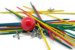 Sticks, Rubber Ball and Jacks. Colorful sticks, jacks and a red rubber ball Royalty Free Stock Photo