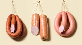 Sticks salami or sausages hanging on the ropes. royalty free stock photography