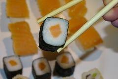 Sticks with salmon maki, sushi royalty free stock photo