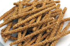 Sticks with sesame. Salted sticks, dotted with sesame Stock Image