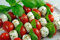 Sticks with tomato, mozzarella and basil Royalty Free Stock Photography