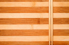 Sticks on wooden background. Chinese bamboo chopsticks closeup striped wooden background Stock Photography