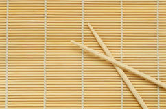 Sticks on wooden background. Chinese bamboo chopsticks closeup striped wooden background Stock Photos