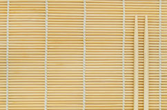 Sticks on wooden background. Chinese bamboo chopsticks closeup striped wooden background Stock Photo