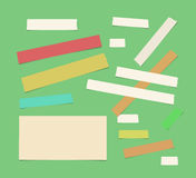 Sticky, adhesive masking tape, ruled paper stuck on green background. Sticky, adhesive masking tape, note paper stuck on green background Royalty Free Stock Images