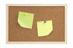 Sticky / Adhesive Note. Two sticky / adhesive note with push pins on a cork board isolated on white background. Plenty of copy space to play with design elements stock photo