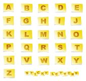 Sticky Alphabet. Letters of the alphabet on yellow post-it like sticky notes Stock Image