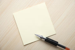 Sticky and ball pen Stock Photography